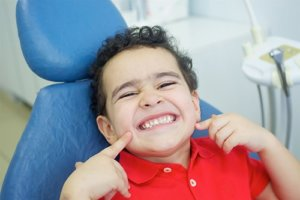Cute kid smiling during National Childrens Dental Health Month